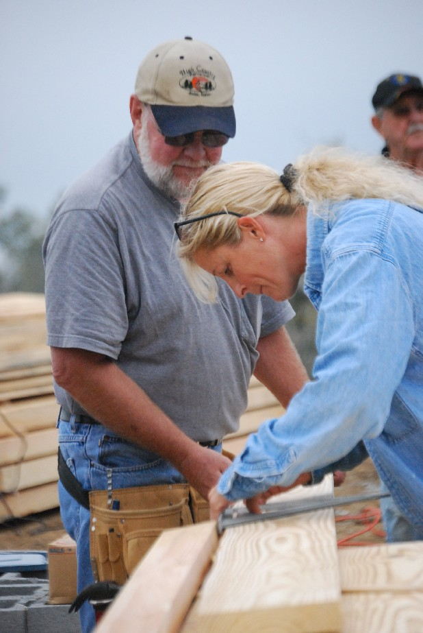 Doug Russell and Linda Moody cut boards for three cabins at Sand Mountain Bible Camp in Trenton, Ga. on Friday morning. Volunteers from various groups worked to rebuild part of the camp that was destroyed by the April tornadoes.