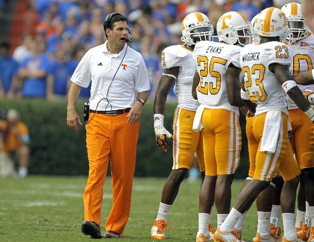 Tennessee head coach Derek Dooley talks to his players in Gainesville, Fla.