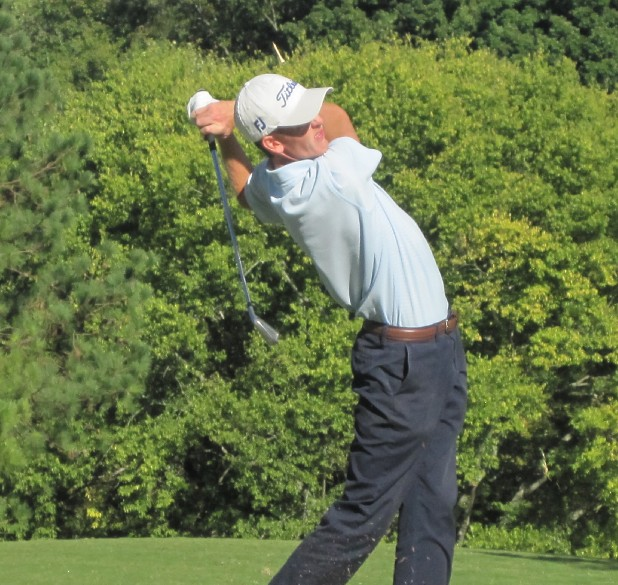 Former University of Tennessee at Chattanooga golfer Jonathan Hodge strikes his tee shot on No. 13 at Cleveland Country Club Monday. Hodge qualified for the Children's Hospital Classic. 