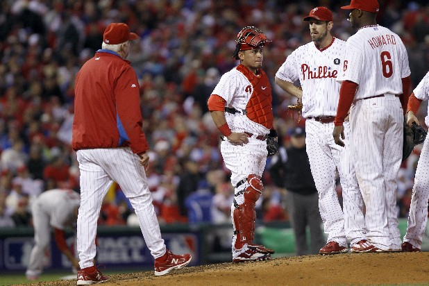 Philadelphia Phillies manager Charlie Manuel, left, walks to the mound to pull starting pitcher Cliff Lee, second from right, as catcher Carlos Ruiz (51) and first baseman Ryan Howard (6) stand nearby, during the seventh inning of baseball's Game 2 of the National League division series with the St. Louis Cardinals Sunday, Oct. 2, 2011 in Philadelphia. (AP Photo/Matt Rourke)