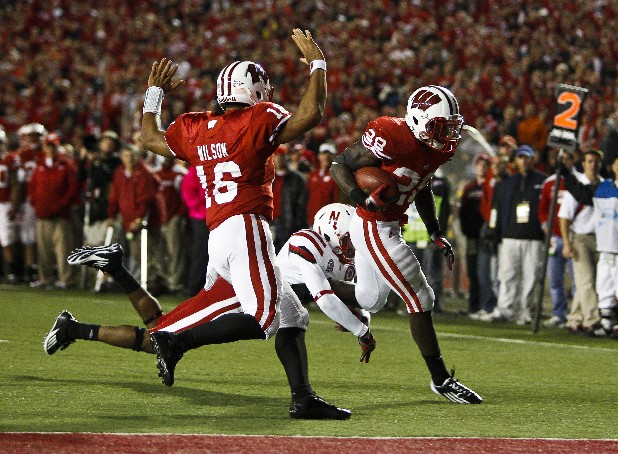 Wisconsin running back Montee Ball (28) runs in for touchdown against Nebraska cornerback Andrew Green (11) with Wisconsin quarterback Russell Wilson (16) during the second half of an NCAA college football game Saturday, Oct. 1, 2011, in Madison, Wis. (AP Photo/Andy Manis)