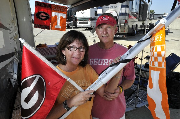 Bobbi and Rick Davis from Niceville, Fla., pause while tailgating before the Georgia-Tennessee football game Friday in Knoxville. Bobbi Davis grew up in Kingsport , Tenn., and graduated from the University of Tennessee Knoxville in 1978. Rick Davis grew up on Signal Mountain and  graduated from Georgia in 1978.