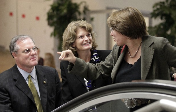 From left, Sen. Mark Pryor, D-Ark., Sen. Lisa Murkowski, R-Alaska, and Sen. Amy Klobuchar, D-Minn., arrive for the vote on President Barack Obama's $447 billion jobs bill at the Capitol in Washington on Tuesday. Republicans defeated the bill's chances to advance.