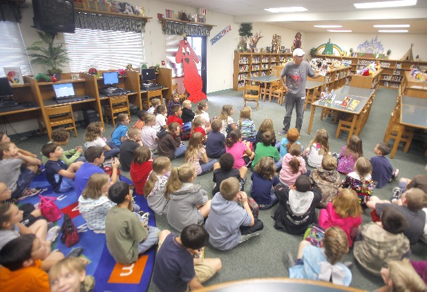 David Mark Lopez talks with third-graders at North Hamilton Elementary School on Wednesday. Lopez is a lawyer and author of a series of children's historical fiction.