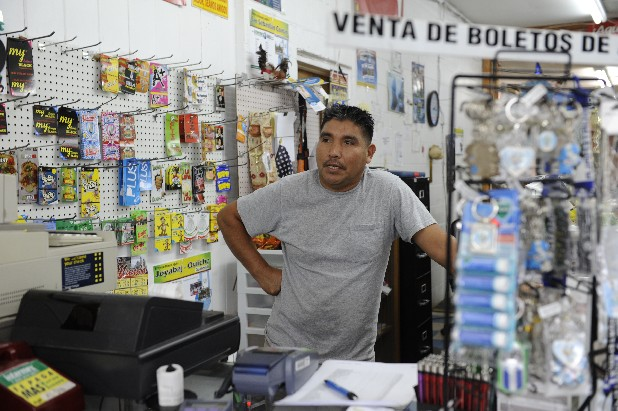 Silvestre Juan stands inside his store, Tienda Latino, in Fort Payne, Ala., while discussing Alabama's immigration law.