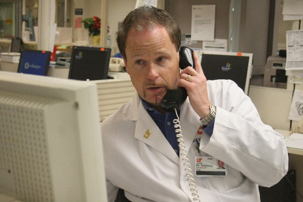 Dr. David Seaberg makes a phone call in the Erlanger hospital Emergency Room on Thursday. Dr. Seaberg is the first dean of the UT College of Medicine, Chattanooga campus.
