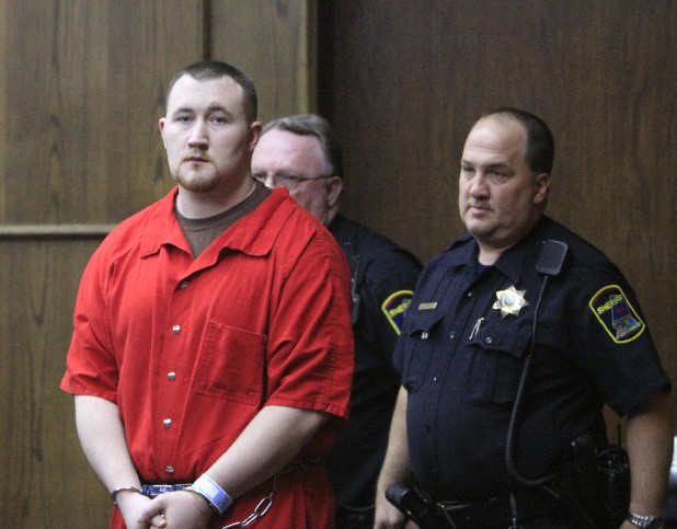 Jesse Mathews is escorted into court on Oct. 11.