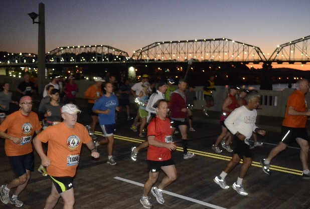 Runners cross the Market St. Bridge shortly after 7 a.m. at the beginning of the 7 Bridges Marathon.