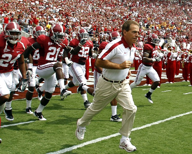 Alabama coach Nick Saban leads the Alabama Crimson Tide onto the field.