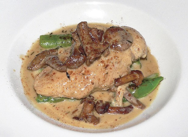 Poached chicken with chanterelle mushrooms and grilled asparagus was among entree choices at Easy Bistro on Broad Street during Harvested Here Restaurant Week. This celebration of local ingredients continues through Sunday at 18 restaurants around town. Find out more at www.slowchattanooga.org.