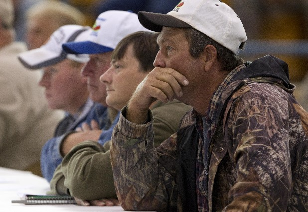 Produce farmers and brokers listen during a meeting Thursday of farmers and state officials to discuss the impact of the Alabama Immigration law on their livelihoods in Oneonta, Ala. From left: Jonathan Clayton, Henry Clayton, Kevin Watkins and Wade Whited.