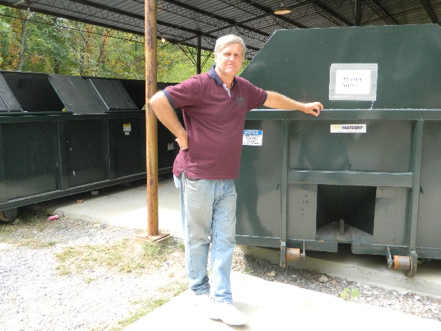 Steve Melton, supervisor of Bradley County's recycling centers, stands by the recycling bins for plastic at the Peerless Road center.