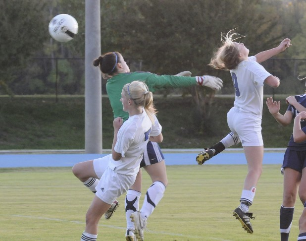 Izzy Phillips of GPS, right, scores on a header past Pope John Paul II goalkeeper Megan Mihaliak in the first round of the Division 2-AA State Soccer Playoffs at GPS Saturday.
