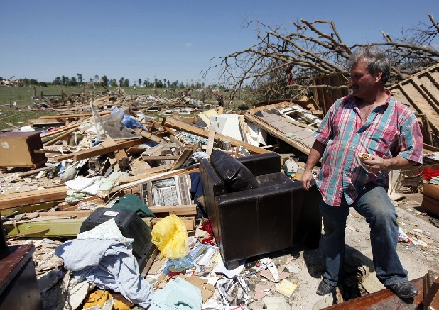 Ray Cardin stands in the spot where he survived the April 27 tornado huddled with his fiancee and dog in the center of their Rainsville, Ala., residence.