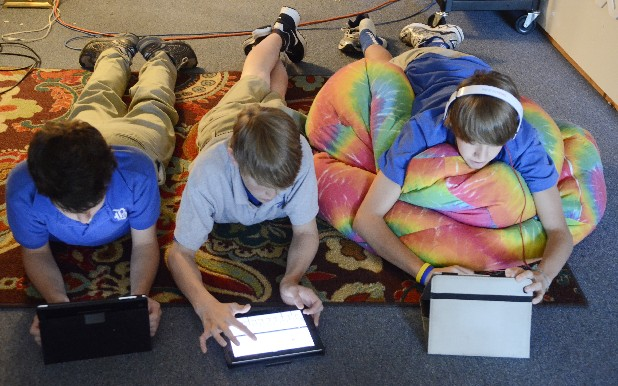 Matt Rogers, Cooper Hodge and Will Greer, from left, use iPads in eighth-grade boys Bible class at Boyd-Buchanan School, where the devices are provided for student use in nearly all classrooms in grades 6 through 12.