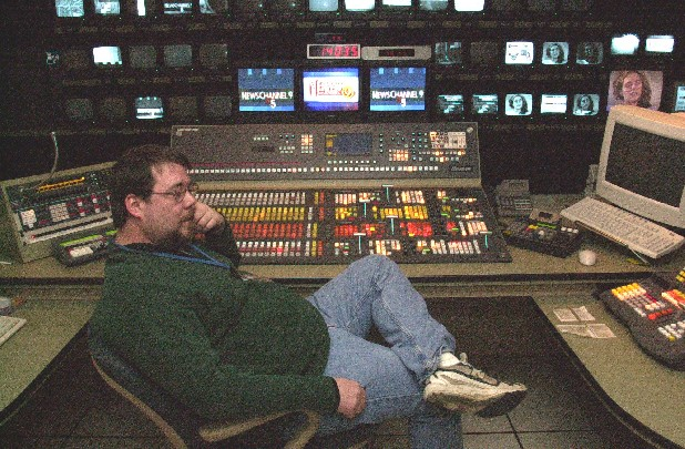WTVC Channel 9's former director Bob Nolan takes a break from making templates in this file photo.