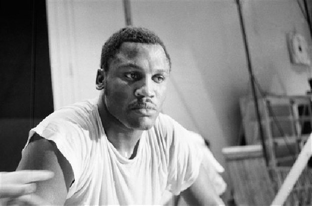 FILE - In this Feb. 3, 1970, file photo, Joe Frazier pauses after a workout at New Yorkís Madison Square Garden. Frazier, the former heavyweight champion who handed Muhammad Ali his first defeat yet had to live forever in his shadow, has died after a brief final fight with liver cancer. He was 67. The family issued a release confirming the boxer's death on Monday night, Nov. 7, 2011. (AP Photo/Marty Lederhandler, File)