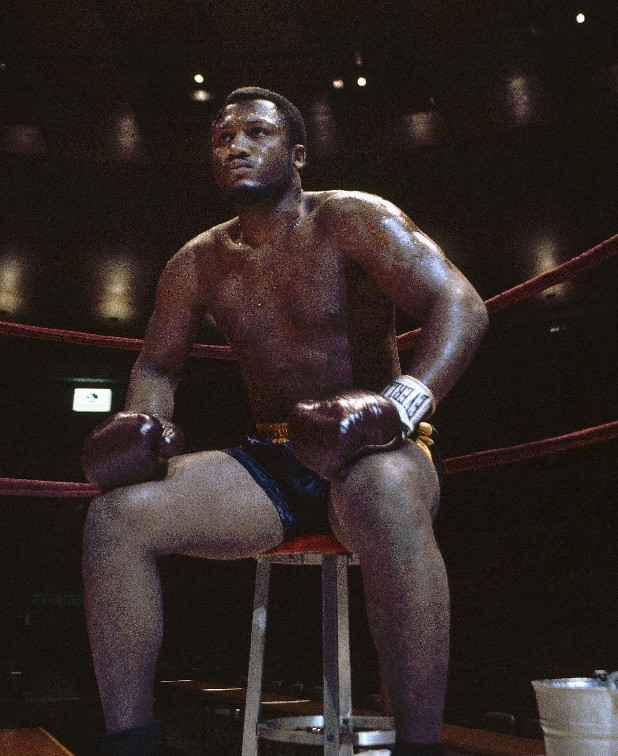 In this undated photo, boxer Joe Frazier is seated in the corner of the ring. The former heavyweight champion died after a brief fight with liver cancer. He was 67. The family issued a release confirming the boxer's death on Monday, Nov. 7, 2011. (AP Photo/File)