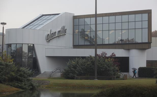 The Olan Mills facility sits off Highway 153.