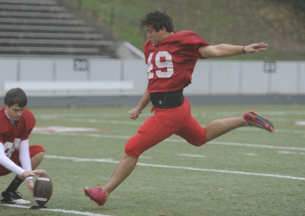 Henrique Ribeiro, No. 49, practices his kick during  practice Wednesday at Baylor School.  Ribeiro is a Brazilian exchange student who had never, before transferring, played football.  He is considered one of the top kickers in the state.