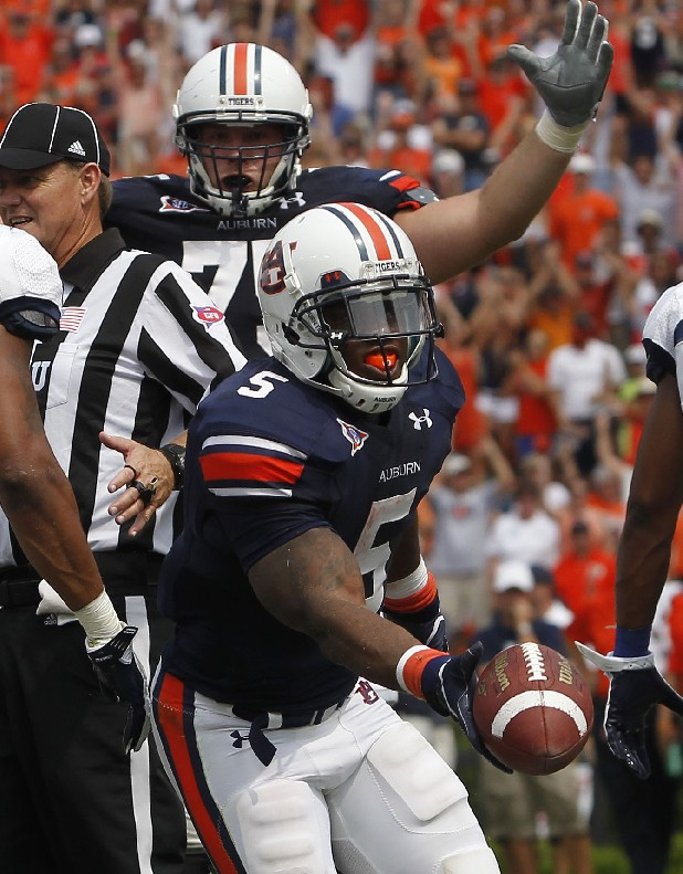 Auburn Tigers running back Michael Dyer (5) celebrates his game-winning touchdown over Utah State in September. Auburn won 42-38.