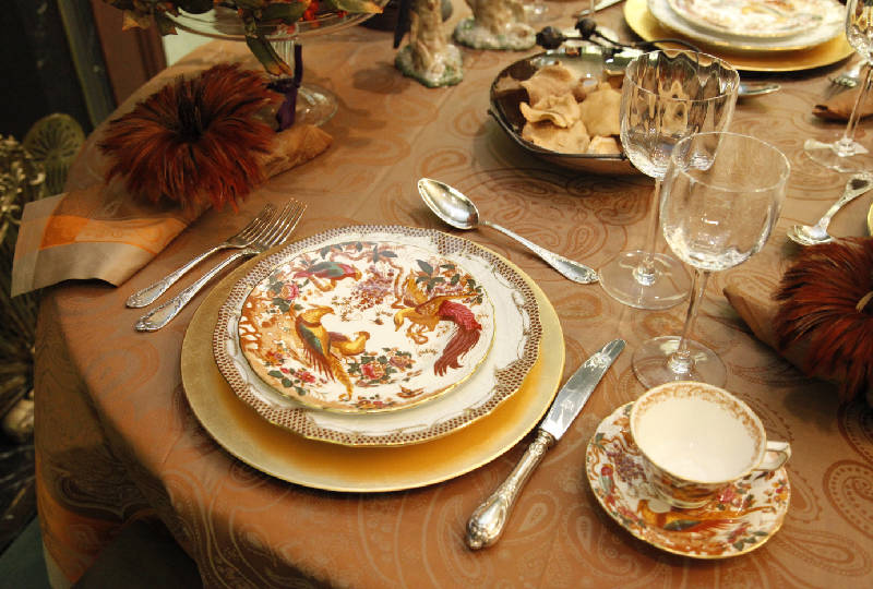 In this place setting the base plate also called a charger or service plate acts as an underplate for the dish holding the first course in this case a ... & Table setting ideas for Thanksgiving dinner | Times Free Press