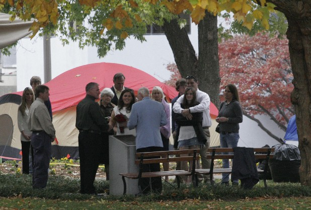 With Occupy Chattanooga tents standing nearby, the Rev. Robert Williams performs the wedding ceremony of Lauren Filter and Mark Melville at the Hamilton County Courthouse on Monday.