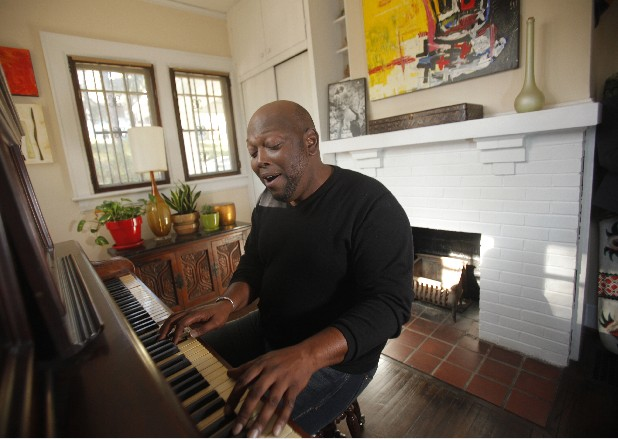 Shane Morrow plays piano and sings in the sunroom of his Brainerd home. Morrow is founder of the artist networking group The Creative Underground.
