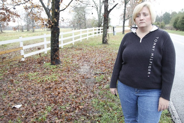Beth Oliver stands Wednesday near where Jordan Queen was recently involved in a fatal car crash along Lee Clarkson Road just east of Chickamauga, Ga. Oliver has started a petition to change the section of road where Queen crashed to help prevent future fatalities.