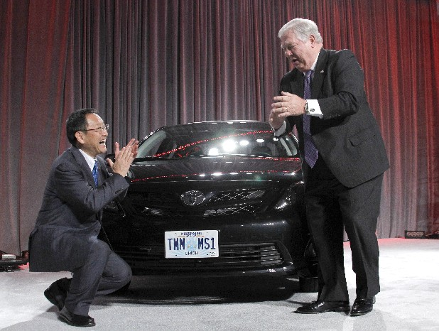 Toyota Motor Corp. president Akio Toyoda , left, and Gov. Haley Barbour celebrate the unveiling of Mississippi's new auto tag face plate on the front of the first Corolla built in Mississippi during a ceremony that marks production start at Toyota's auto manufacturing plant in Blue Springs, Miss., Thursday.