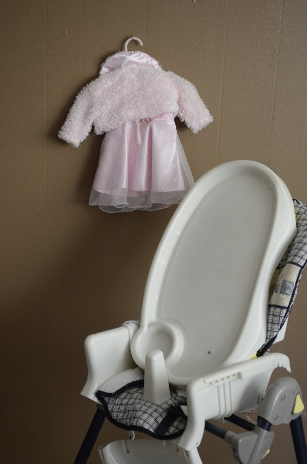 An infant's clothes and a high chair are seen in one of the rooms at the home of Domitina Mendez and her husband, Ovidio Mendez, Guatemalan indigenous Mayans who lost custody of their five children. The Georgia Department of Child Protective Services took their children in 2008, and in June a Whitfield County judge permanently removed their parental rights in part because they don't speak English and the judge felt the parrents couldn't take care of the children's special needs and dozens of monthly doctor's visits.