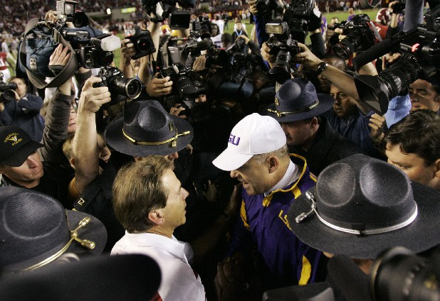 Alabama coach Nick Saban, front left, and LSU coach Les Miles, front right, shake hands in Tuscaloosa, Ala.