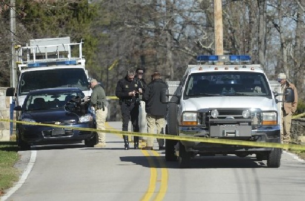 Law enforcement officials set up near 1419 East Brow Road on Signal Mountain today.