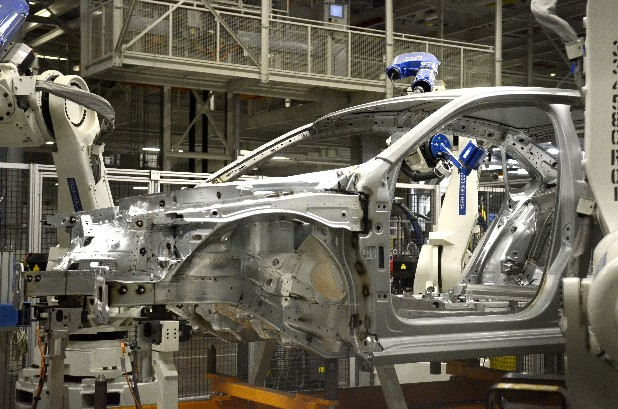 A Volkswagen Passat chassis gets a robotic inspection at the Chattanooga manufacturing plant Thursday.