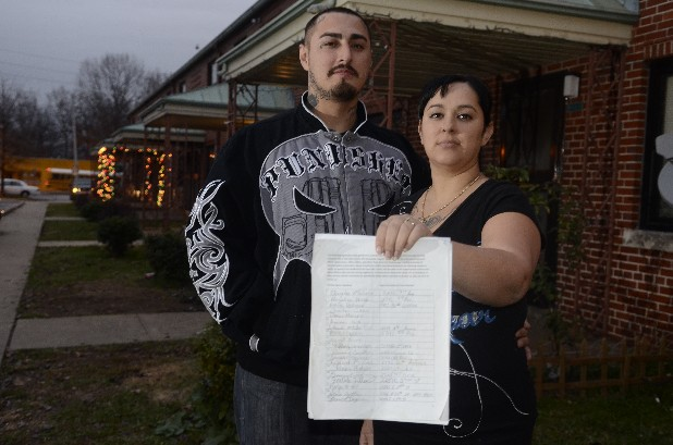 Beaneit Seagrove, right, photographed with her fiance, Hector Martinez, in the East Lake Courts, has started a petition collecting more than 140 signatures from East Lake Courts residents to have three Chattanooga Housing Authority policemen fired for harassment.