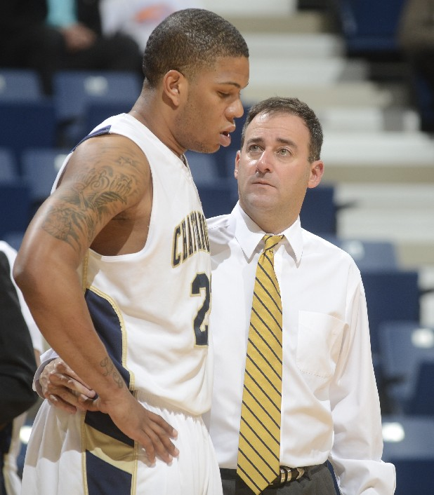 UTC coach John Shulman, right, talks to Chris Early during the game against Warren Wilson Monday at McKenzie Arena.