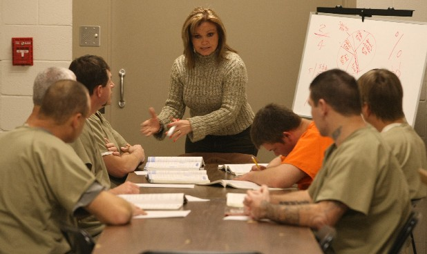 Retired teacher Charlotte Cain goes over fractions with inmates at the Sequatchie County Jail during a GED class in this file photo.