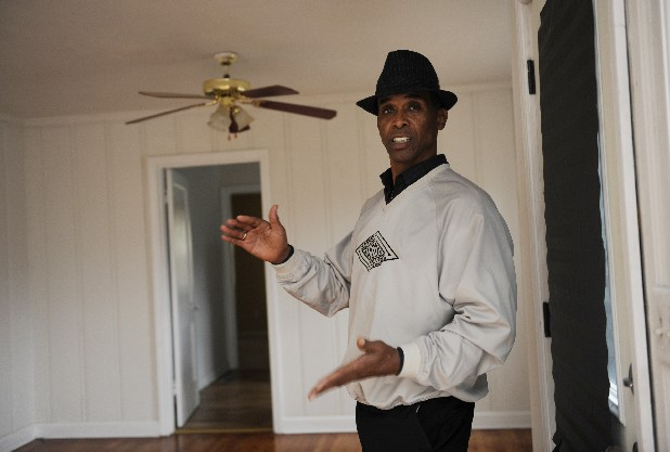 Stan Brown, who owns and manages properties rented and available to Section 8 residents, stands inside a house Brown re