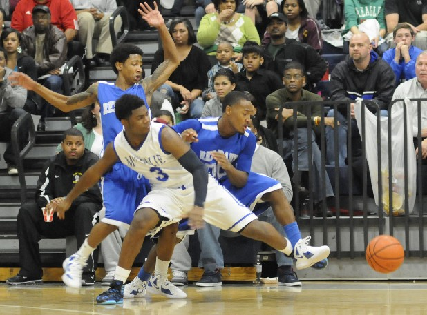 Red Bank's Ivan Newsom, left, and Niguia McDuffie follow a loose ball behind McCallie's C.J. Reese on Thursday at CSAS.