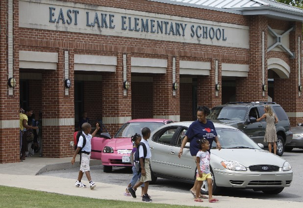 Latoshia Gustus, right, walks her four children home from East Lake Elementary School in this file photo.