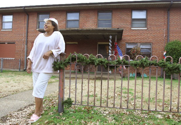 Aileen Young stands outside of her home in the Chattanooga Housing Authority's Harriet Tubman complex. Young is upset about having to move and hearing about plans to close the Tubman site as the community has become family to her.