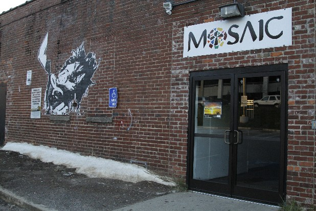 Mosaic's clearly marked back entrance leads to a parking lot maintained by the Hamilton County Sheriff's Office. Several signs posted throughout the lot make that known to the public.