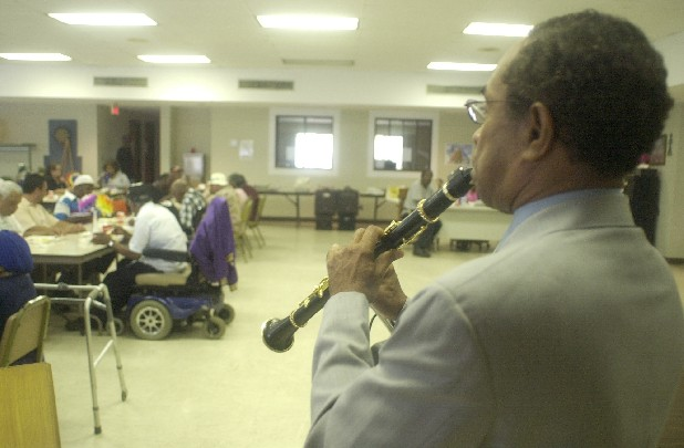 Booker T. Scrugg, Jr. plays clarinet for residents of the Boynton Terrace Apartments in the Golden Gateway.