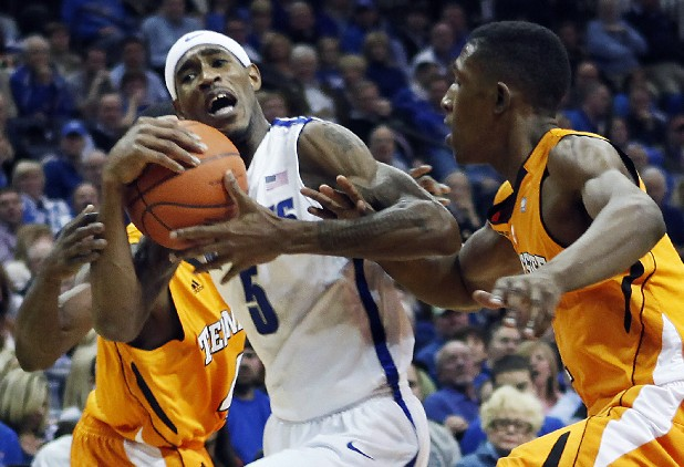 Memphis guard Will Barton (5) gets tangled with Tennessee guard Josh Richardson, right, in the second half of an NCAA college basketball game on Wednesday, Jan. 4, 2012, in Memphis, Tenn. Memphis won 69-51. (AP Photo/Lance Murphey)