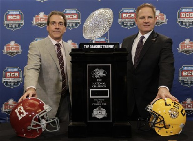 LSU head coach Les Miles, right, poses for a picture with Alabama head coach Nick Saban during a news conference for the BCS National Championship college football game Sunday, Jan. 8, 2012, in New Orleans.