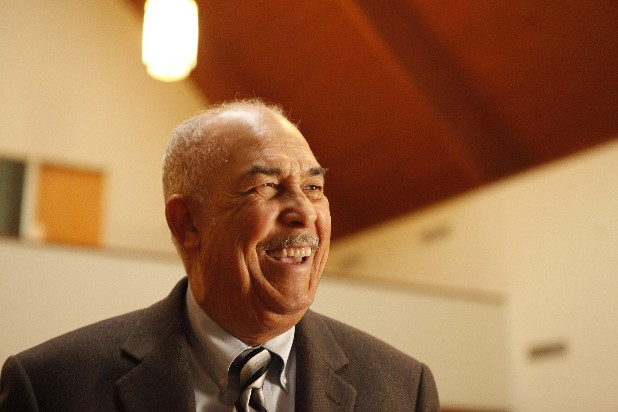 The Rev. Paul McDaniel laughs in the sanctuary of Second Missionary Baptist Church on Tuesday. McDaniel will be the speaker for the 42nd annual Martin Luther King Jr. Day celebration.