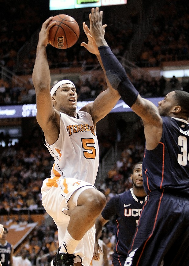 Tennessee's Jarnell Stokes goes for a basket against Connecticut's Alex Oriakhi during their upset win over Connecticut Saturday in Knoxville.