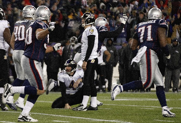 Baltimore Ravens kicker Billy Cundiff (7) and ball holder Sam Koch watch after Cundiff missed a 32-yard field goal in the closing seconds of their AFC Championship NFL football game Sunday, Jan. 22, 2012, in Foxborough, Mass. The Patriots defeated the Ravens 23-20 to win the AFC Championship. (AP Photo/Elise Amendola)