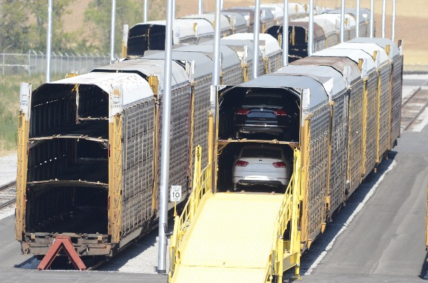 Train cars await the loading of new Passats at the Chattanooga Volkswagen manufacturing plant at the Enterprise South Industrial Park in this file photo.