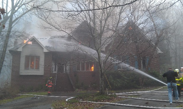 Firefighters battled a large home fire on Signal Mountain.